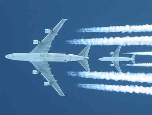 Shot of a EK/Atlas Air 747 (2000ft above us) being chased by EK B777-200 (A6-EML, 4000ft above us) right at its tail. Captured out of a EK (now thats coincidence...) B777 flightdeck (through left #1 window upwards - thats why the neck was twisted Wink. Us at FL340, 747 at 360, other B777 at 380.