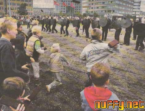 kids attacking police with bricks