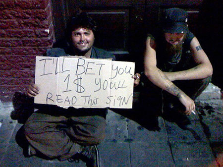 homeless people holding funny sign