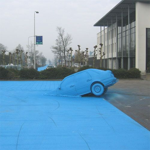 Painting road in blue - street art