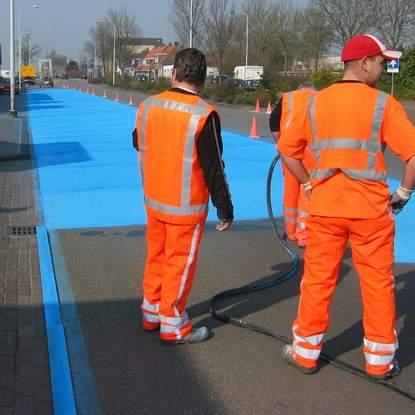 Painting road in blue - street art