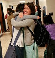 school girls hug